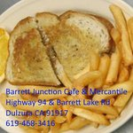 Patty melt on rye served with your choice of fries or coleslaw