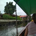 Photo of Small Teak Boat Canal Adventure