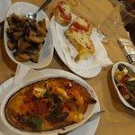 Bread with tomato and cheese, garlic mushrooms, saganaki shrimp, mussels saganaki
