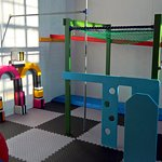 Children's play area. Mini monkey bars, climbing frame, ladder, slope, bean bag and foam shapes.