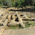 Dozens of exposed burial tombs