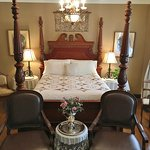 The Schiller Strasse Parlor Suite has a queen size bed & chandelier. The bathroom has a shower.