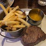 Fillet steak with garlic butter and skinny fries,