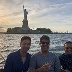 In front of the Statue of Liberty