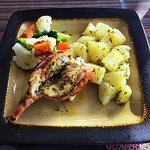 Grilled lobster tail with Parsley Potatoe & steamed vegetables pic by Jamaul Roots
