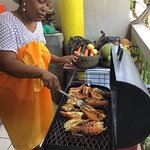 Lobsters being grilled on BBQ by one of the chefs Marcia Augustine pic by Jamaul Roots