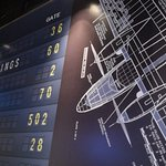 Blue Print of an Aircraft and Airport Departure Board as the Wallpaper