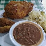 Fried chicken with cabbage and pintos.
