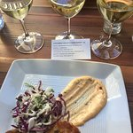A flight of Chardonnays with delicious crab cakes