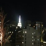 the glittering empire state building taken from the hotel rooftop