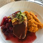 Boneless pork chop with sweet potato mash and cranberry relish