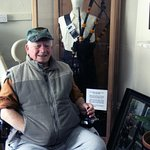 The fondly remembered Piper Bill Millin with his famous D-Day bagpipes which are on display.