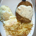 Chicken fried steak with eggs and hash browns! Yum!