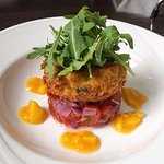 Cod, Crab, Chili and Lime Fishcake served on a bed of Pico de Gallo with a Mango coulii