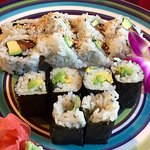 Avocado sushi and a salmon and avocado roll