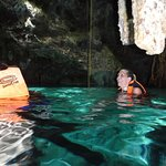 Enjoying the crystal clear cenote water