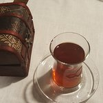 The traditional Turkish tea in glass and the box with check inside