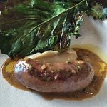 Pork/Veal sausage, onion puree, peppercorn jus, cabbage leaf