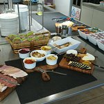Bread, meats, cheeses on the Lounge buffet.