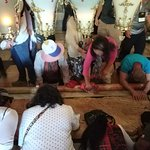 People offering Prayers at the place where Jesus was laid down after cleaning up