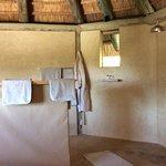 'open plan' bathroom, shower right, loo centre, sink left
