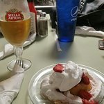 An ice cold beer and a strawberry shortcake