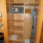 Small closet with safe and ironing board.