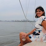 Martina enjoying the evening sail with a glass of wine and the water at her feet.