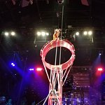 acrobat on top of spinning wheel
