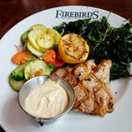 Grilled salmon, veggies and fried spinach.