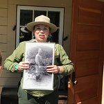 Interpretive Ranger, talking about Fannie Quigley in front of her home.