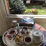 tea in the sitting room, w/view at garden/street