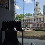 Liberty Bell with Independence Hall in the background.