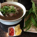 Pho Tai with garnishes