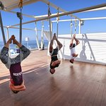 Anti-gravity yoga on the rooftop