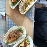 Crispy fish, pulled taco, soft shell crab and halloumi tacos.