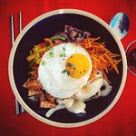 Bibimbap, a traditional rice dish. Mix in the sweet and spicy gochujang paste for amazing flavou