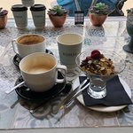 Herbal tea, cappucccino with hazlenut, double shot cappuccino and granola with yoghurt
