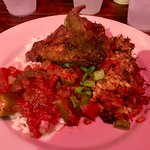 Taste plate with fried chicken, shrimp creole, red beans and rice, rabbit and sausage jambalaya
