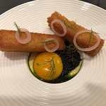 Warm poached egg and dill with caviar