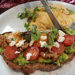 Omelette with avocado & tomatoes & fetta on wholemeal toast.