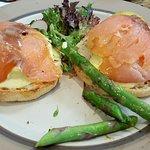 Eggs benedictine with moist smoked salmon & asparagus.