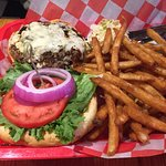 Black and blue burger and fries