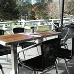 Plenty of outdoor tables on a sunny winter's day