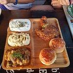 4-choice cold platter, clockwise: patty made of zucchini, buns, imam bayili, humus, tzatziki