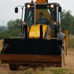 7 year old driving a JCB