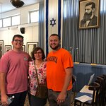 Our family in front of the photo of Theodore Herzl in Independence Hall in Tel Aviv, Israel in J