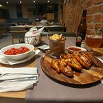 My very favorite last meal in Croatia! chicken wings & roasted red peppers with a blond local be