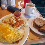 Omelette, hash browns and wheat toast.