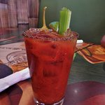 Bloody Mary - with celery stick, chilli, olive and lime wedge. Very healthy.